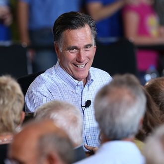 BASALT, CO - AUGUST 02: Republican presidential candidate and former Massachusetts Gov. Mitt Romney greets supporters during a campaign event with Republican Governors at Basalt Public High School on August 2, 2012 in Basalt, Colorado. One day after returning from a six-day overseas trip to England, Israel and Poland, Mitt Romney is campaigning in Colorado before heading to Nevada. (Photo by Justin Sullivan/Getty Images)