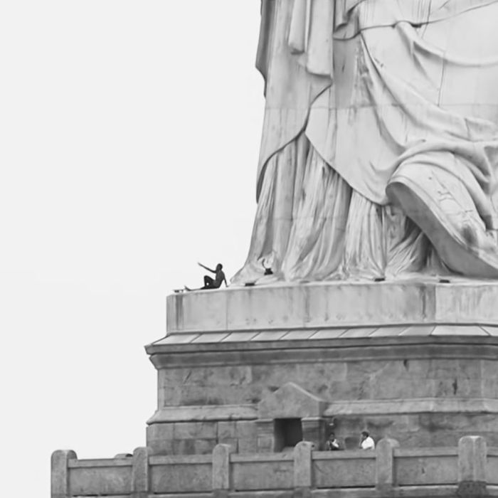 woman climbs statue of liberty over trump immigration policy