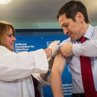 Dr. Thomas Frieden, Director of the Centers for Disease Control and Prevention, receives a flu shot from Sharon Bonadies at the conclusion of a press conference at the National Press Club in Washington, Thursday, Sept. 18, 2014.