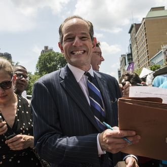 NEW YORK, NY - JULY 08: Former New York Gov. Eliot Spitzer collects signatures from citizens to run for comptroller of New York City on July 8, 2013 in New York City. Spitzer resigned as governor in 2008 after it was discovered that he was using a high end call girl service. (Photo by Andrew Burton/Getty Images)