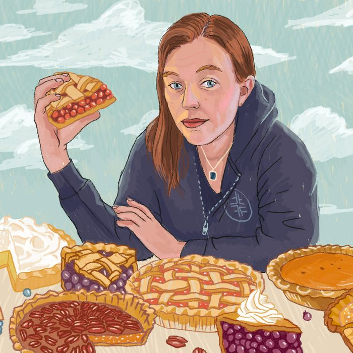 Illustration of Emily Flake in a blue hoodie surrounded by pies