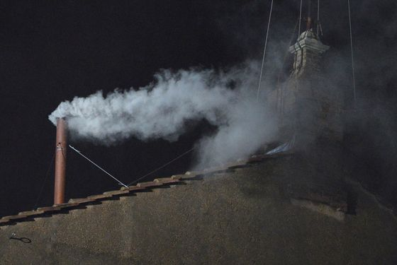 White smoke rises from the chimney on the roof of the Sistine Chapel meaning that cardinals elected a new pope on the second day of their secret conclave on  March 13, 2013 at the Vatican. AFP PHOTO / ALBERTO PIZZOLI        (Photo credit should read ALBERTO PIZZOLI/AFP/Getty Images)