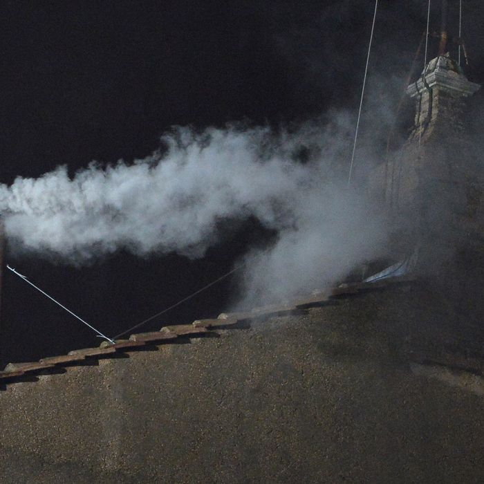 White smoke rises from the chimney on the roof of the Sistine Chapel meaning that cardinals elected a new pope on the second day of their secret conclave on March 13, 2013 at the Vatican.