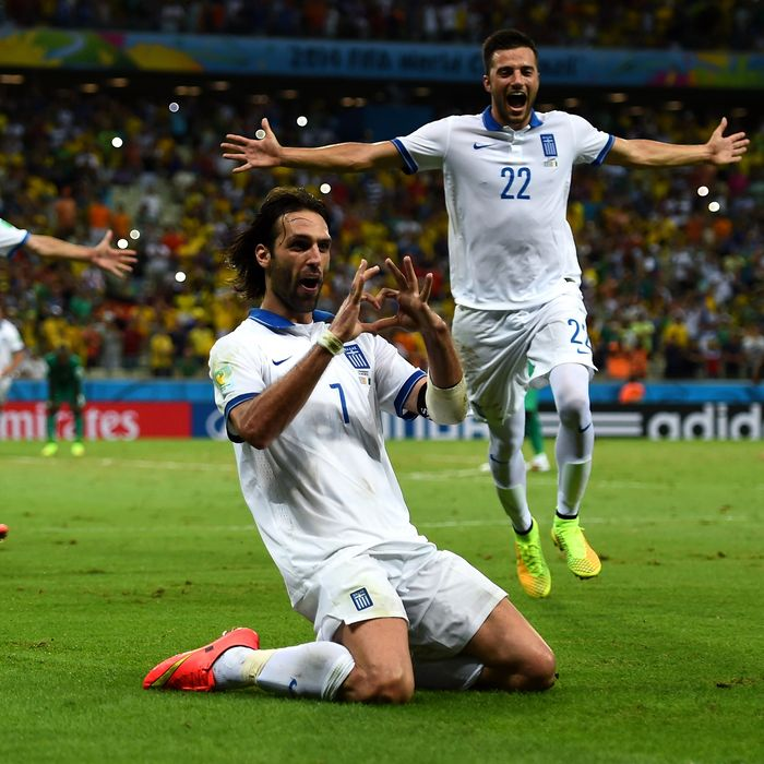 FORTALEZA, BRAZIL - JUNE 24: Giorgos Samaras (2nd R) of Greece celebrates scoring his team's second goal from the penalty spot with his teammates during the 2014 FIFA World Cup Brazil Group C match between Greece and Cote D'Ivoire at Estadio Castelao on June 24, 2014 in Fortaleza, Brazil. (Photo by Lars Baron - FIFA/FIFA via Getty Images)