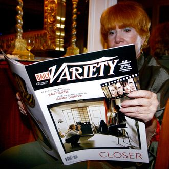 A women reads a magazines at the Variety Magazine's