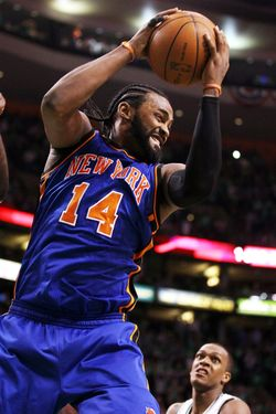 BOSTON, MA - APRIL 17:  Ronny Turiaf #14 of the New York Knicks grabs the rebound as Rajon Rondo #9 of the Boston Celtics defends in Game One of the Eastern Conference Quarterfinals in the 2011 NBA Playoffs on April 17, 2011 at the TD Garden in Boston, Massachusetts. The Boston Celtics defeated the New York Knicks 87-85. NOTE TO USER: User expressly acknowledges and agrees that, by downloading and or using this photograph, User is consenting to the terms and conditions of the Getty Images License Agreement.  (Photo by Elsa/Getty Images) *** Local Caption *** Ronny Turiaf;Rajon Rondo
