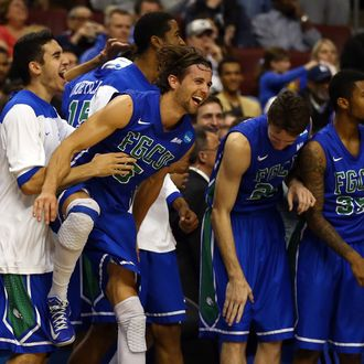 PHILADELPHIA, PA - MARCH 24: Christophe Varidel #5 of the Florida Gulf Coast Eagles celebrates on the bench late in the second half while taking on the San Diego State Aztecs during the third round of the 2013 NCAA Men's Basketball Tournament at Wells Fargo Center on March 24, 2013 in Philadelphia, Pennsylvania. (Photo by Elsa/Getty Images)