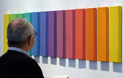 "A man looks at the painting ""Spectrum VI"