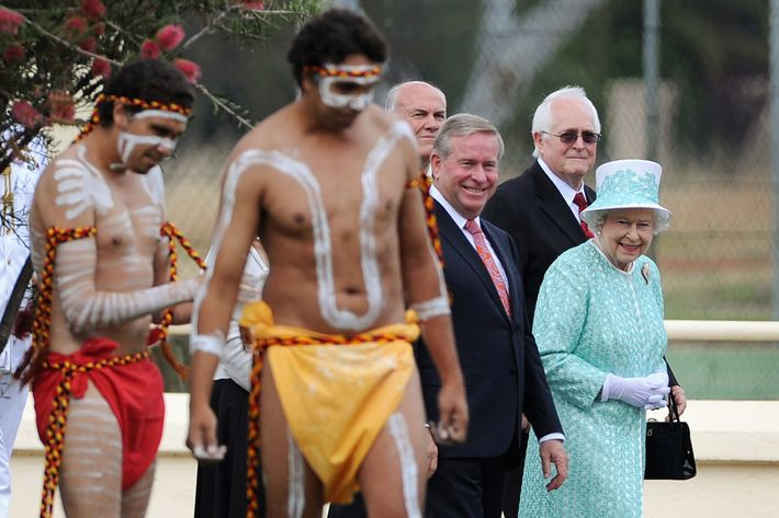 Queen Elizabeth II watching aboriginal dancers during her visit to Clontarf Aboriginal college in Perth, Australia yesterday.