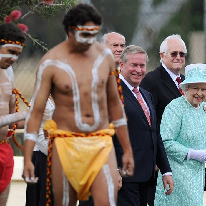 Queen Elizabeth II watching aboriginal dancers during her visit to Clontarf Aboriginal college in Perth, Australia yesterday.