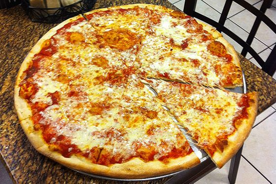 "<b>Cheese & Tomato Sauce</b>    <a href=""http://valentinosnypizzeria.com/"">Valentino's New York Style Pizzeria</a>    <i>Alexandria, Virginia</i>  New York–style pizza isn't elitist, so it sure isn't limited to the biggest cities. This pie is marked by its super-sweet sauce, which is a love-it or hate-it for pizza fanatics. Interesting tidbit: The owners, who hail from Queens, only use natural spring water to make their pies."