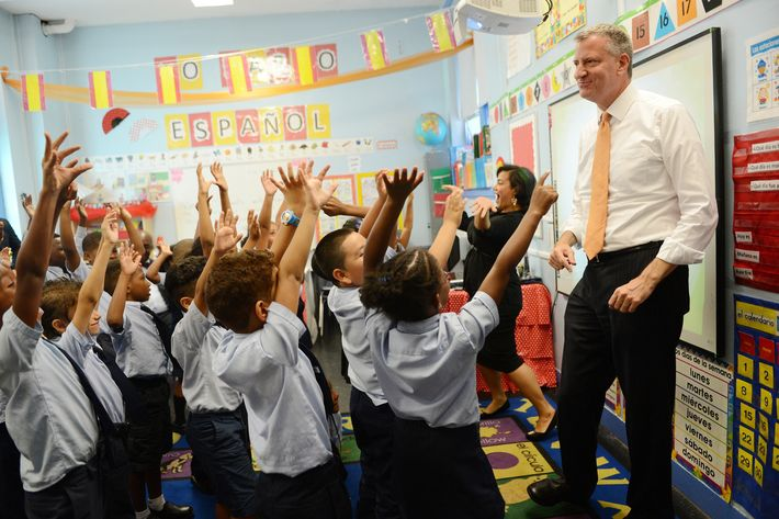 NEW YORK, NY - SEPTEMBER 4: New York Mayor Bill de Blasio visits a second grade Spanish class at Amber Charter School in Manhattan on the first day of NYC public schools, September 4, 2014 in New York City. New York Mayor Bill de Blasio is touring universal pre-kindergarten programs throughout the city. (Photo by Susan Watts-Pool/Getty Images)