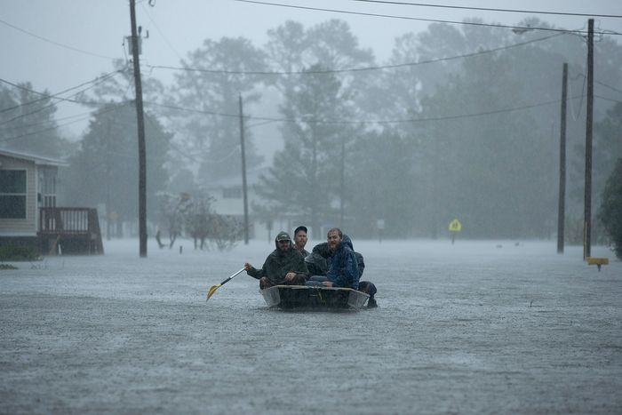 Volunteers help rescue residents from their flooded homes on Friday in New Bern, North Carolina.