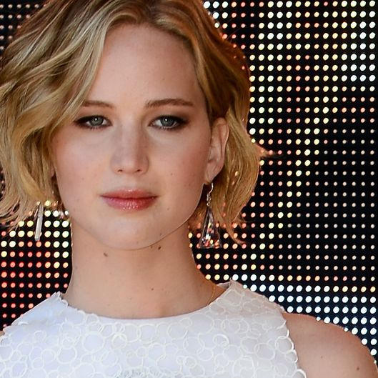 "Actress Jennifer Lawrence attends ""The Hunger Games: Mockingjay Part 1"" photocall at the 67th Annual Cannes Film Festival on May 17, 2014 in Cannes, France."