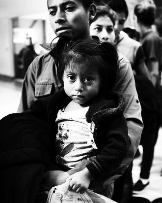 A Guatemalan father and his daughter at a bus station following release from Customs and Border Protection in McAllen, Texas.