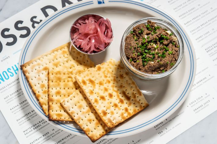 """The vegetarian chopped liver, served with toasted matzo and pickled onion, is new to the uptown location. """"We used to sell it at the store,"""" Tupper says. """"One of my great aunts, Ida, made it, and I think we sold it even before we sold real chopped liver."""" This version is made with toasted walnuts, mushrooms, string beans, chickpeas, caramelized onions, and chopped eggs."""