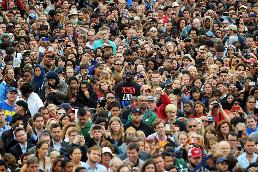 Supporters listens as US President Barack Obama speaks during a campaign rally at the George Mason University in Fairfax, Virginia, on October 19, 2012.