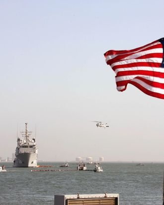 A US Navy Ocean Tug ship and a helicopter of the Bahrain-based Fifth Fleet particpate in a crisis response exercise in a port in the capital Manama, 06 November 2007.