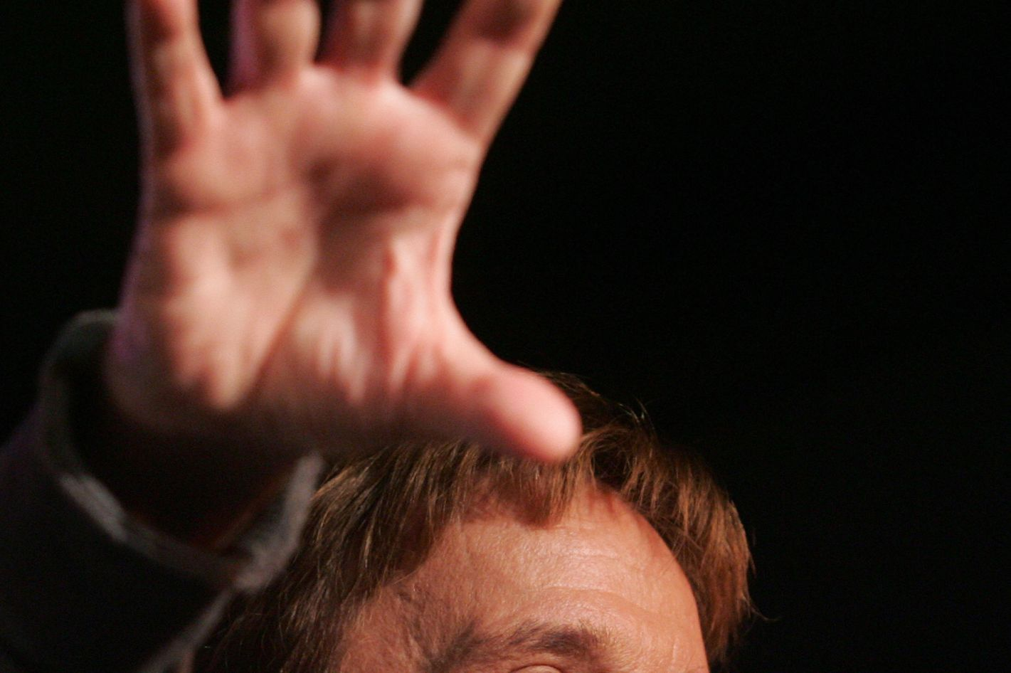 """US Actor Chuck Norris speaks during a """"Huck and Chuck"""" rally for Republican Presidential hopeful and former Arkansas Governor Mike Huckabee at the Val Air Ballroom in Des Moines, Iowa, 01 January 2008. AFP PHOTO/SAUL LOEB (Photo credit should read SAUL LOEB/AFP/Getty Images)"""