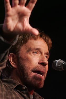 "US Actor Chuck Norris speaks during a ""Huck and Chuck"" rally for Republican Presidential hopeful and former Arkansas Governor Mike Huckabee at the Val Air Ballroom in Des Moines, Iowa, 01 January 2008. AFP PHOTO/SAUL LOEB (Photo credit should read SAUL LOEB/AFP/Getty Images)"