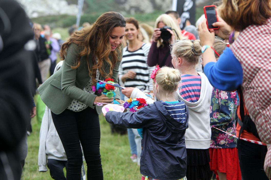 HOLYHEAD, WALES - AUGUST 30:  Catherine, Duchess of Cambridge attends the start of The Ring O'Fire Anglesey Coastal Ultra Marathon on August 30, 2013 in Holyhead, Wales.  (Photo by Paul Lewis - WPA Pool/Getty Images)