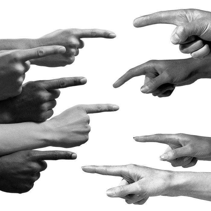 5 pointing fingers of multiple ethnicities