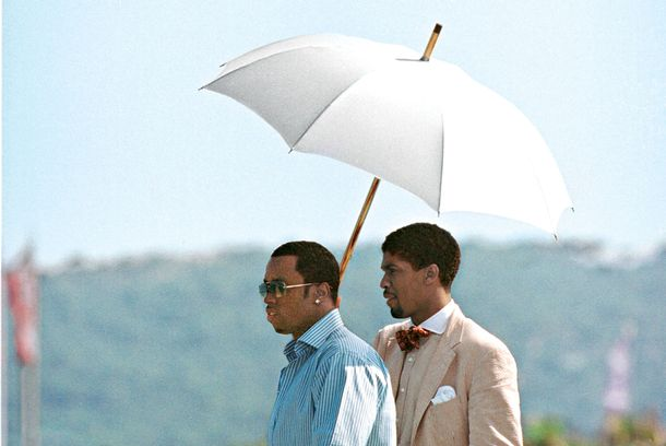 Mandatory Credit: Photo by BEImages (588594h)Sean 'P. Diddy' Combs and Farnsworth BentleySean 'P. Diddy' Combs at Club 55July 27, 2001 - Saint Tropez, FranceSean 'P. Diddy' Combs and Farnsworth Bentley (holding umbrella) at Club 55.Photo Æ Ghost/Maxppp/BEImages***U.S. SALES ONLY!***