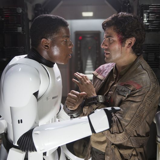 Star Wars: The Force AwakensL to R: Finn (John Boyega) and Poe Dameron (Oscar Isaac)Ph: David James© 2015 Lucasfilm Ltd. & TM. All Right Reserved.