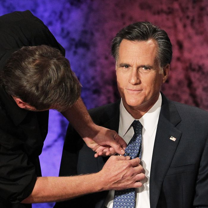 HANOVER, NH - OCTOBER 11: Former Massachusetts Gov. Mitt Romney prepares for the Republican Presidential debate hosted by Bloomberg and the Washington Post on October 11, 2011 at Dartmouth College in Hanover, New Hampshire. Eight GOP candidates met for the first debate of the 2012 campaign focusing solely on the economy. (Photo by Justin Sullivan/Getty Images)