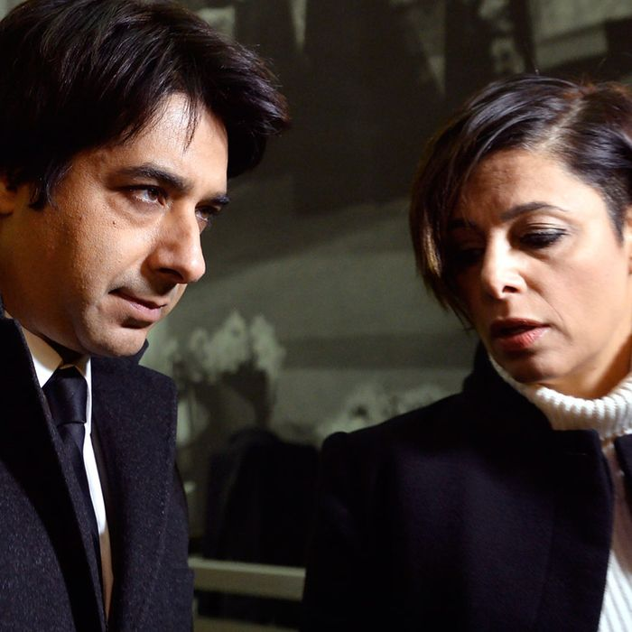 Jian Ghomeshi with his lawyer, as protesters picketed the courthouse.
