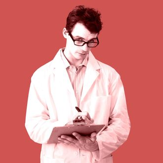 Scientist Taking Notes --- Image by ? Radius Images/Corbis