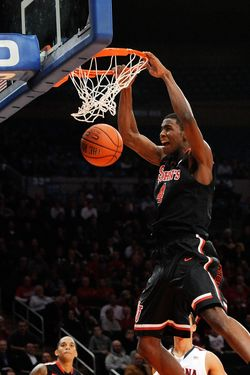 NEW YORK, NY - NOVEMBER 17:  Moe Harkless #4 of the St. John's Red Storm makes a dunk against Arizona Wildcats during the 2K Sports Classic Benefiting Coaches Vs Cancer at Madison Square Garden on November 17, 2011 in New York City.  (Photo by Patrick McDermott/Getty Images)