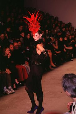Kate Moss walks in a 1997 Philip Treacy show.