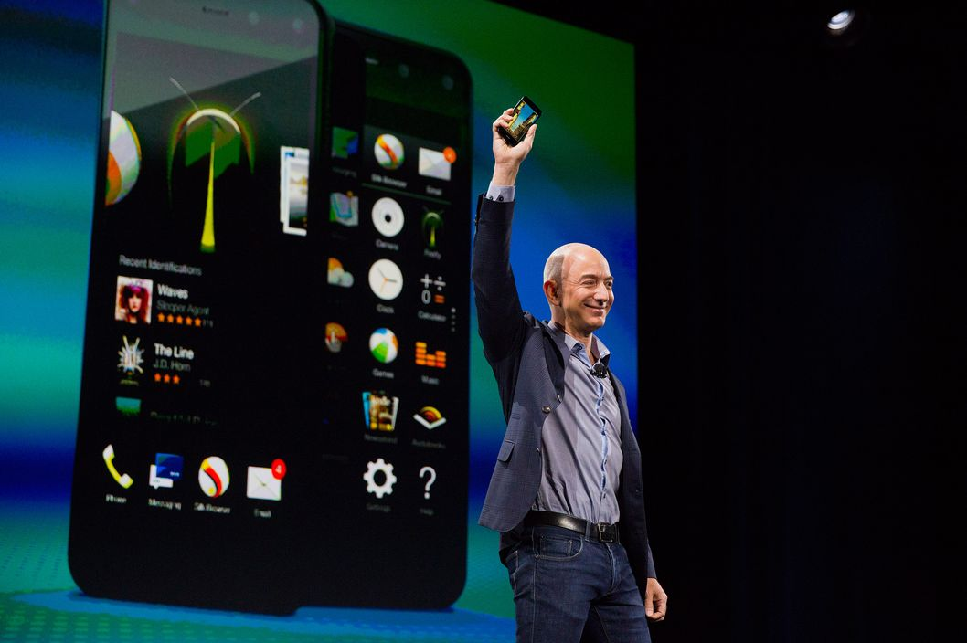 Jeff Bezos, chief executive officer of Amazon.com Inc., unveils the Fire Phone during an event at Fremont Studios in Seattle, Washington, U.S., on Wednesday, June 18, 2018. Amazon.com Inc. jumped into the crowded smartphone market with its own handset called Fire Phone, ramping up competition with Apple Inc. and Samsung Electronics Co. Photo: Mike Kane/Bloomberg via Getty Images