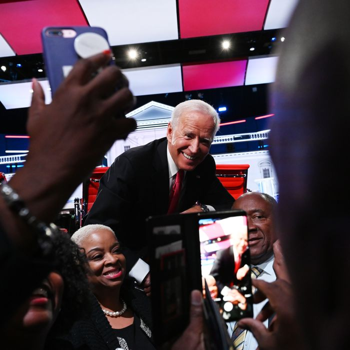 Presidential candidate Former vice president Joe Biden poses for photos on stage at the conclusion of the Washington Post and MSNBC fifth Democratic presidential primary debate at the from Tyler Perry Studios on November 20, 2019 in Atlanta, Georgia.