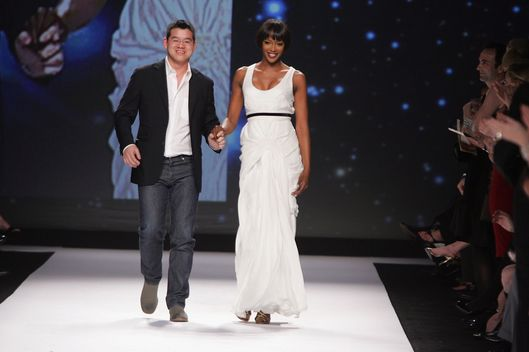Model Naomi Campbell and designer Peter Som walk the runway