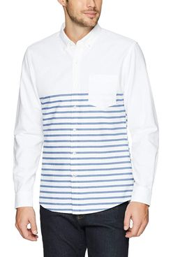 A male model wearing a Goodthread's long sleeve white collared shirt with faded blue stripes starting halfway down and a breast pockets with a pair of dark wash jeans. The Strategist - A Bunch of Men's Button Downs (From $16) Are on Sale at Amazon.