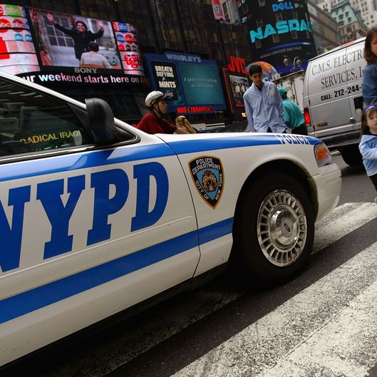 NEW YORK - MAY 26:  Pedestrians in Times Square walk past a police car May 26, 2004 in New York City. The U.S. fears that al Qaeda may be plotting an attack inside the country or against U.S. interests abroad. Despite these warnings, the government has no plans to raise the terror threat level and has no details on when, where or how an attack might occur.  (Photo by Spencer Platt/Getty Images)