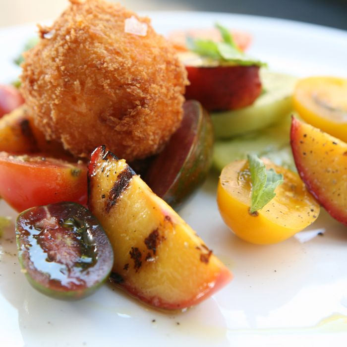 Root & Bone's tomato salad with fried pimento cheese and peaches.