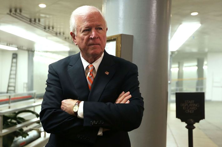 U.S. Select Committee on Intelligence ranking member Sen. Saxby Chambliss (R-GA) waits for his turn to speak to members of the media after a hearing on the Benghazi attack November 16, 2012 on Capitol Hill in Washington, DC. Former Central Intelligence Agency (CIA) Director David Petraeus testified before the committee about the September 11 attacks on the American diplomatic compound in Benghazi, Libya, that killed Ambassador Christopher Stevens and three other Americans.