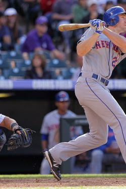 DENVER, CO - APRIL 29:  Mike Baxter #23 of the New York Mets pinch hits for a base hit against the Colorado Rockies in the 10th inning at Coors Field on April 29, 2012 in Denver, Colorado. The Mets defeated the Rockies 6-5 in 11 innings.  (Photo by Doug Pensinger/Getty Images) *** Local Caption *** Mike Baxter