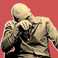 Man Rubbing His Eyes --- Image by ? Oliver Eltinger/Corbis