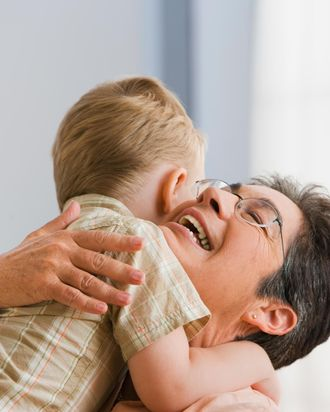 Grandmother hugging grandson