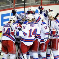 Henrik Lundqvist #30 of the New York Rangers celebrates with teammates after a 5-0 victory against the Washington Capitals in Game Seven of the Eastern Conference Quarterfinals during the 2013 NHL Stanley Cup Playoffs at the Verizon Center on May 13, 2013 in Washington, DC.