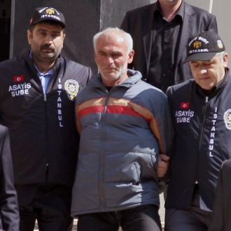 Police officers escort a Turkish man identified only as Ziya T., suspected of killing New York City woman Sarai Sierra who died from a fatal blow to the head in Istanbul in January, outside a security office in Istanbul, Turkey, Monday, March 18, 2013. (AP Photo)