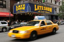 "NEW YORK - OCTOBER 16:  A taxi drives past the exterior of ""Late Show with David Letterman"" at the Ed Sullivan Theatre as people look on October 16, 2008 in New York City.  (Photo by Bryan Bedder/Getty Images)"