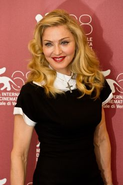 "VENICE, ITALY - SEPTEMBER 01:  Madonna poses during the""W.E."" photocall at the Palazzo Del Cinema during the 68th Venice Film Festival on September 1, 2011 in Venice, Italy.  (Photo by Ian Gavan/Getty Images)"