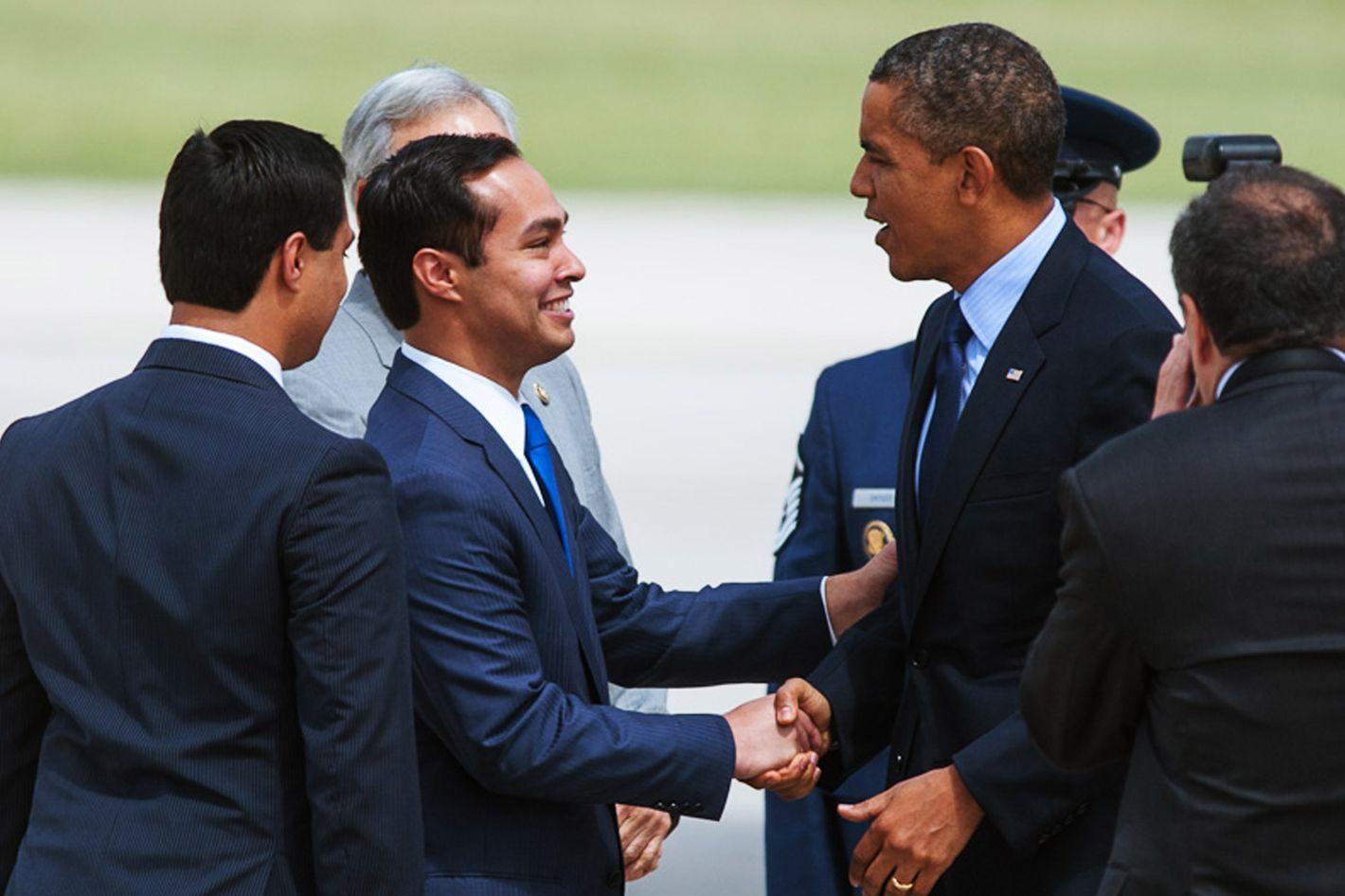 President Barack Obama is greeted by San Antonio Mayor Julian Castro upon his arrival Tuesday, July 17, 2012  in San Antonio. (AP Photo/Bahram Mark Sobhani)