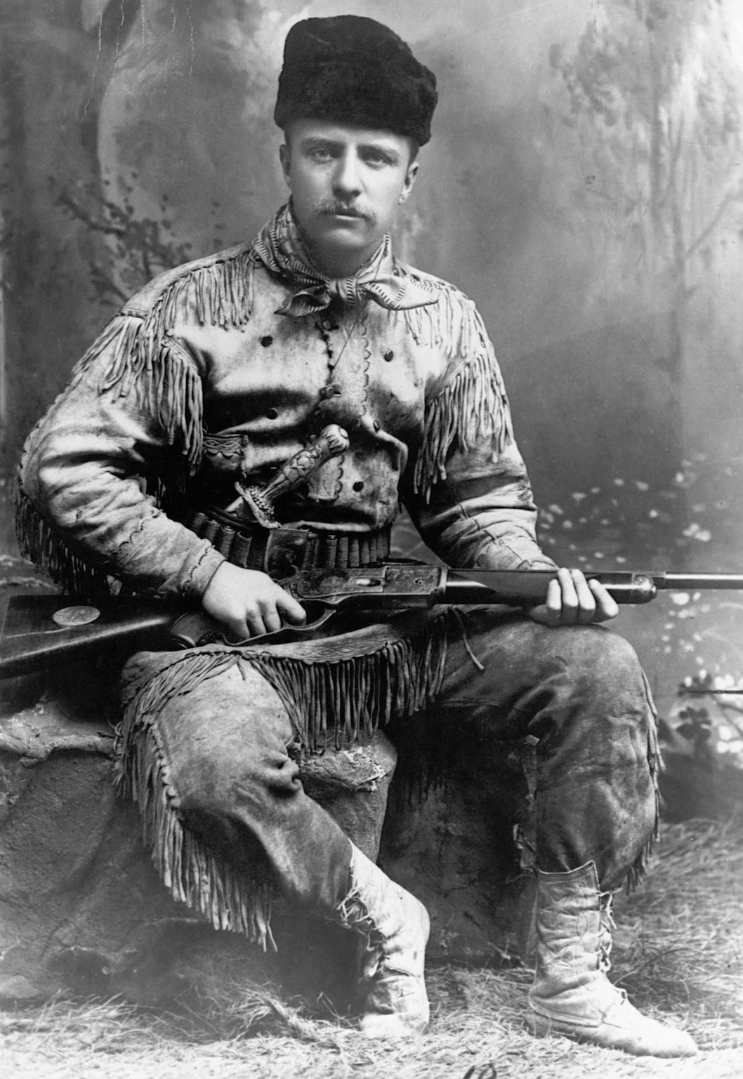 1885, USA --- A portrait of Theodore Roosevelt (1858-1919) in buckskin, without his trademark glasses. This portrait is dated 1885, the year he retired to his ranch in the Dakota Territory, following the death of his mother and first wife. He would go on to become the Police Commissioner of New York City, Assistant Secretary of the Navy, a hero of the Spanish-American War, Governor of New York,  the 26th President of the US, and a winner of the Nobel Peace Prize. --- Image by ? CORBIS