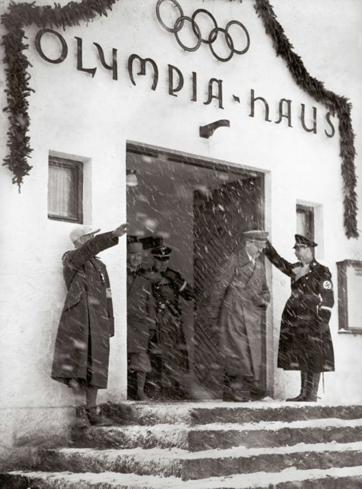 GERMANY - JUNE 02:  Adolf Hitler leaving the Olympic House during the Olympic Games at Garmisch-Partenkirchen. Photography. Germany. 1936.  (Photo by Imagno/Getty Images) [Adolf Hitler beim Verlassen des Olympia-Hauses waehrend der Olympischen Spiele in Garmisch-Partenkirchen. Photographie. Deutschland. 1936.]